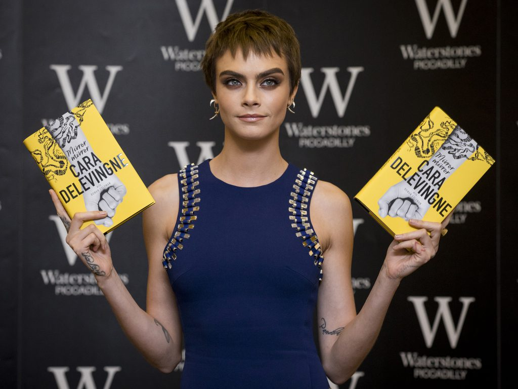 Cara Delevigne with her book