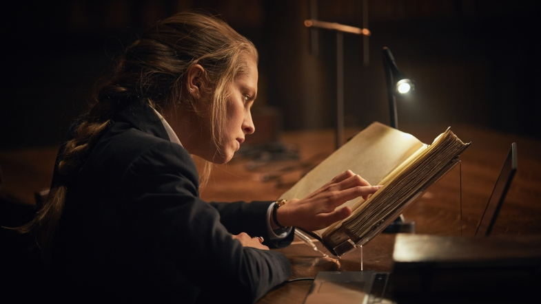 Teresa Palmer as Diana Bishop reading a book - A Discovery of Witches
