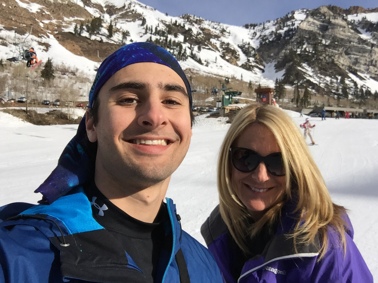 Jesse Galganov with his mother Alisa Clamen in front of snowy mountains