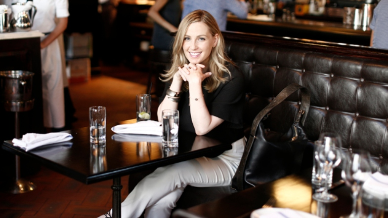Jessica Knoll sitting at a table in a restaurant