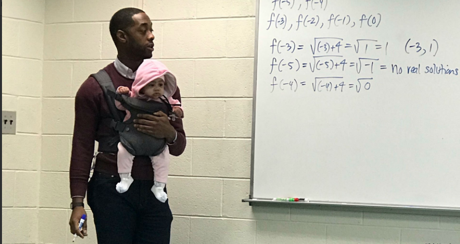 Prof. Alexander Holds Baby