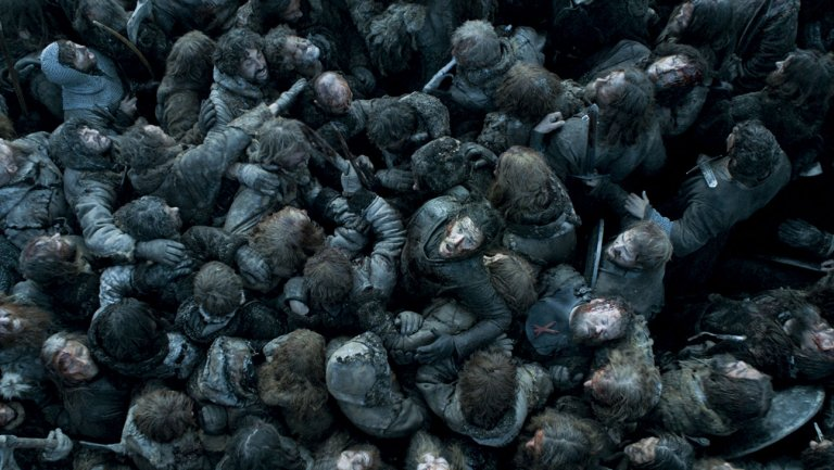 Jon Snow sits amidst a pile of corpses as he struggles to break free
