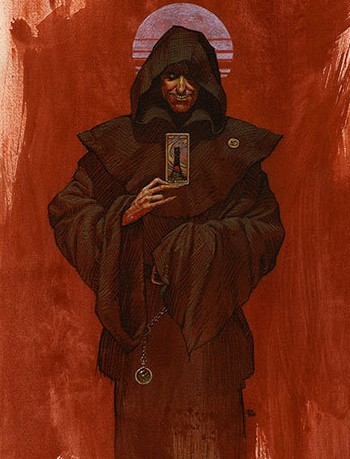 The dark, cloaked figure of Randall Flagg holding a playing card before a red backdrop