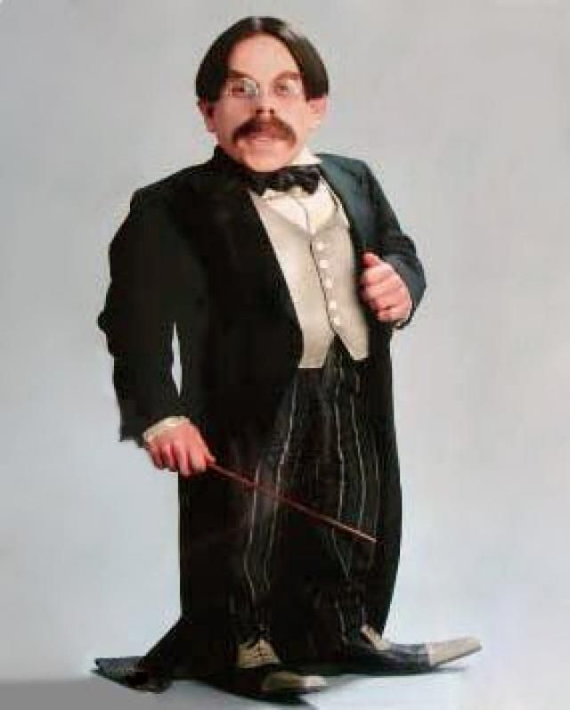 The diminutive Filius Flitwick standing in a tuxedo and holding a wand