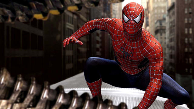 Spider-Man sits crouched on a runaway train, facing the villainous Dr. Octopus