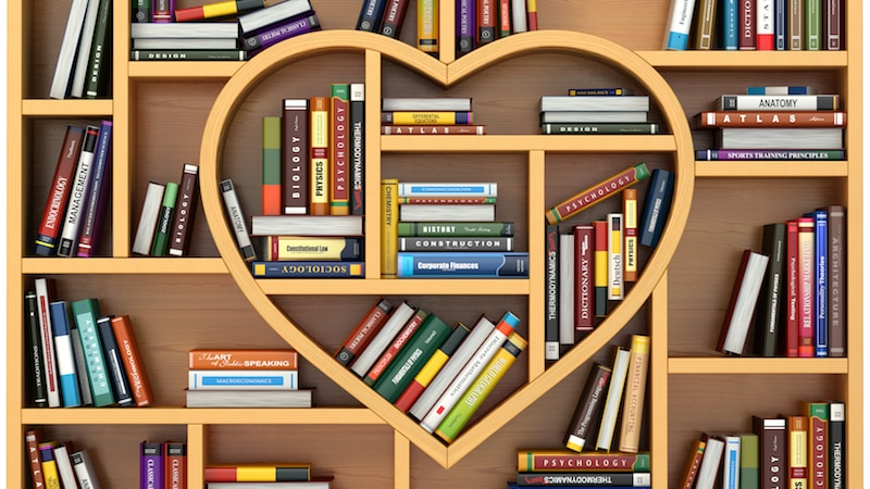 Books on a heart-shaped library shelf